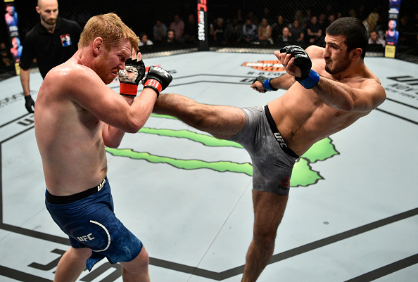 GDANSK, POLAND - OCTOBER 21: (R-L) Ramazan Emeev of Russia kicks Sam Alvey in their middleweight bout during the UFC Fight Night event inside Ergo Arena on October 21, 2017 in Gdansk, Poland. (Photo by Jeff Bottari/Zuffa LLC)