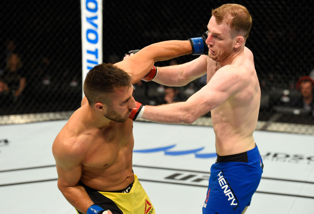 GLASGOW, SCOTLAND - JULY 16: (L-R) Daniel Teymur of Sweden punches Danny Henry of Scotland in their lightweight bout during the UFC Fight Night event at the SSE Hydro Arena Glasgow on July 16, 2017 in Glasgow, Scotland. (Photo by Josh Hedges/Zuffa LLC)