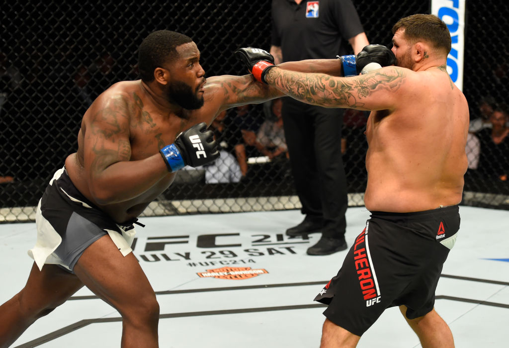 GLASGOW, SCOTLAND - JULY 16:  (L-R) Justin Willis punches James Mulheron of England in their heavyweight bout during the UFC Fight Night event at the SSE Hydro Arena Glasgow on July 16, 2017 in Glasgow, Scotland. (Photo by Josh Hedges/Zuffa LLC)