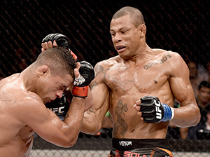 Alex Oliveira of Brazil punches Gilbert Durinho of Brazil in their lightweight bout during the UFC Fight Night at Maracanazinho Gymnasium on March 21, 2015 in Rio de Janeiro, Brazil. (Photo by Buda Mendes/Zuffa LLC)