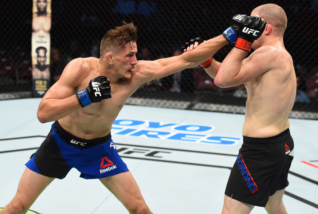 HOUSTON, TX - FEBRUARY 04:  (L-R) Niko Price punches Alex Morono in their welterweight bout during the UFC Fight Night event at the Toyota Center on February 4, 2017 in Houston, Texas. (Photo by Jeff Bottari/Zuffa LLC)