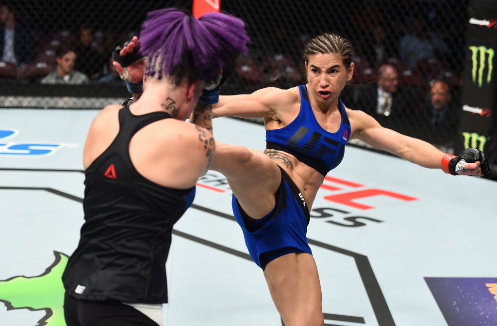 HOUSTON, TX - FEBRUARY 04:  (R-L) Tecia Torres kicks Bec Rawlings of Australia in their women's strawweight bout during the UFC Fight Night event at the Toyota Center on February 4, 2017 in Houston, Texas. (Photo by Jeff Bottari/Zuffa LLC)