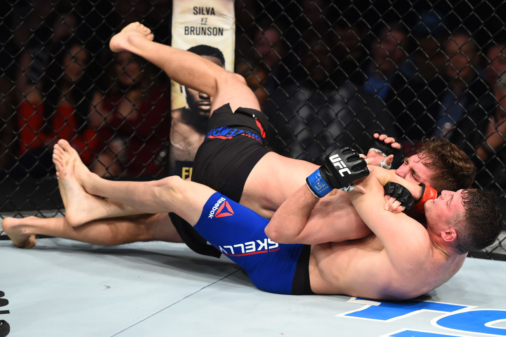 HOUSTON, TX - FEBRUARY 04:  (L-R) Chas Skelly submits Chris Gruetzemacher in their featherweight bout during the UFC Fight Night event at the Toyota Center on February 4, 2017 in Houston, Texas. (Photo by Jeff Bottari/Zuffa LLC)