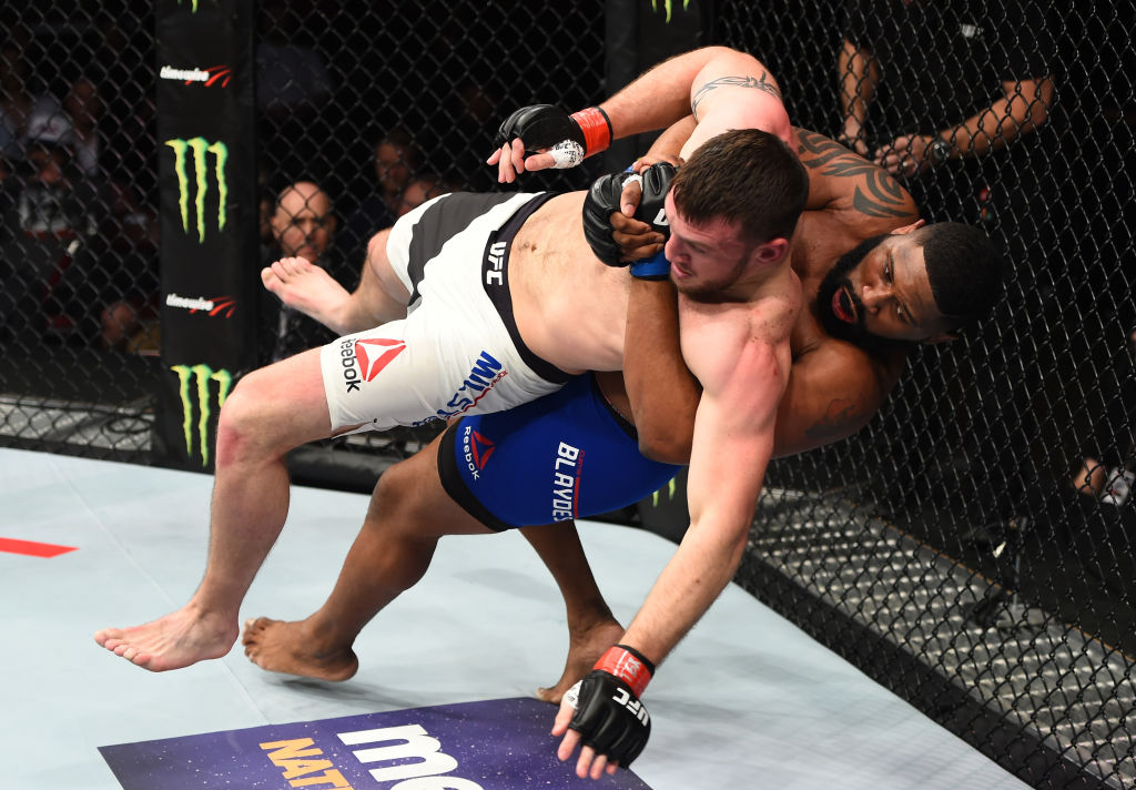 HOUSTON, TX - FEBRUARY 04:  (R-L) Curtis Blaydes takes down Adam Milstead in their heavyweight bout during the UFC Fight Night event at the Toyota Center on February 4, 2017 in Houston, Texas. (Photo by Jeff Bottari/Zuffa LLC)