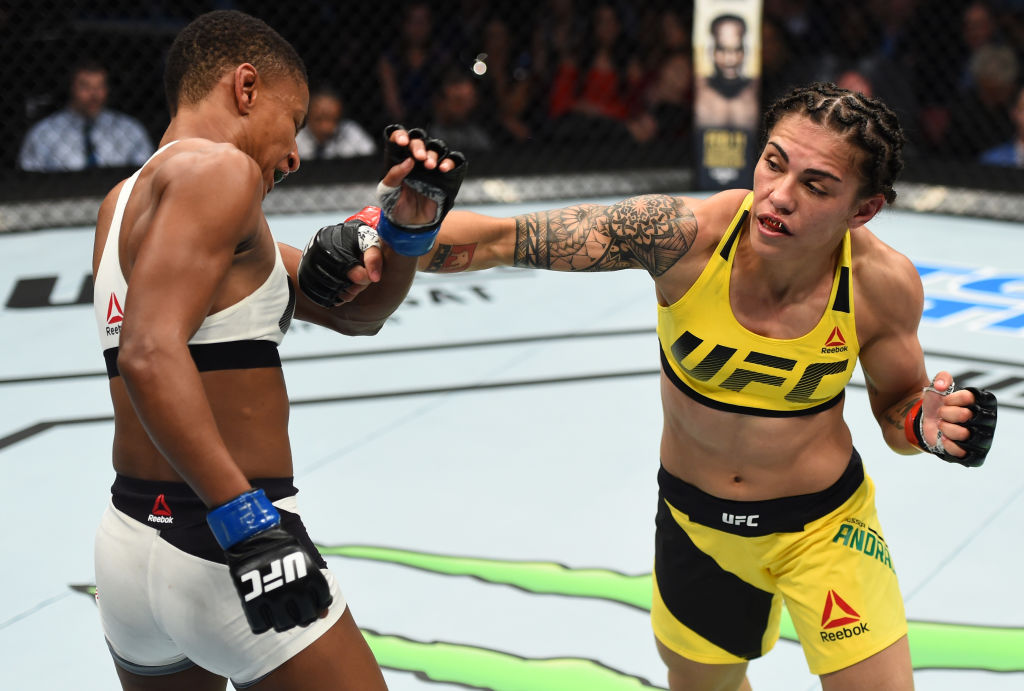HOUSTON, TX - FEBRUARY 04:  (R-L) Jessica Andrade of Brazil punches Angela Hill in their women's strawweight bout during the UFC Fight Night event at the Toyota Center on February 4, 2017 in Houston, Texas. (Photo by Jeff Bottari/Zuffa LLC)