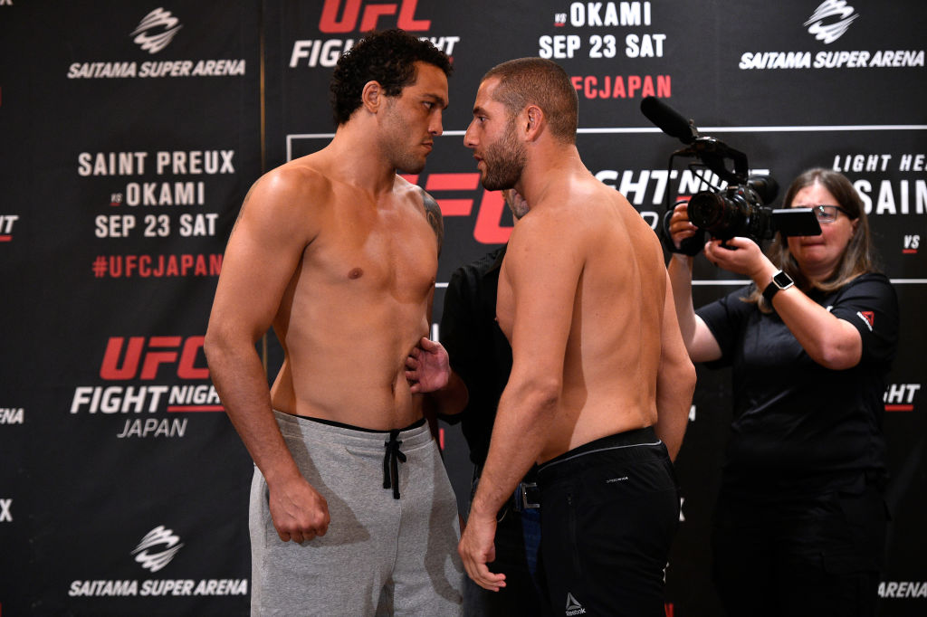 TOKYO, JAPAN - SEPTEMBER 21:  (R-L) Opponents Henrique da Silva of Brazil and Gokhan Saki of Netherlands face off during the UFC Fight Night Weigh-in at the Hilton Tokyo on September 21, 2017 in Tokyo, Japan. (Photo by Jeff Bottari/Zuffa LLC)