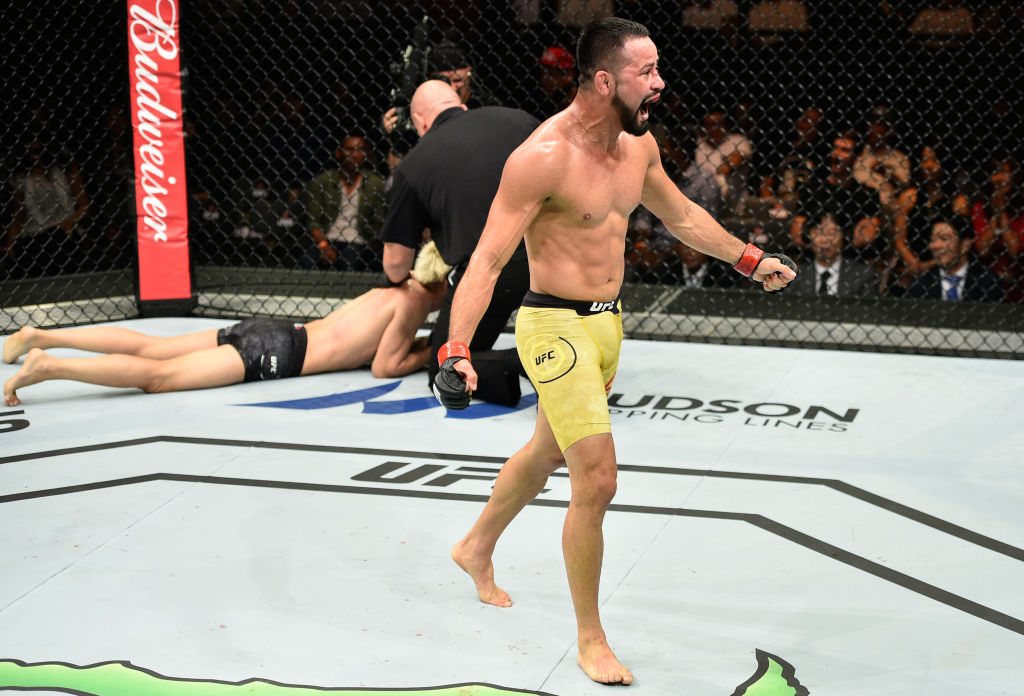 SAITAMA, JAPAN - SEPTEMBER 22: (R-L) Jussier Formiga of Brazil celebrates his submission victory over Ulka Sasaki of Japan in their featherweight bout during the UFC Fight Night event inside the Saitama Super Arena on September 22, 2017 in Saitama, Japan. (Photo by Jeff Bottari/Zuffa LLC)