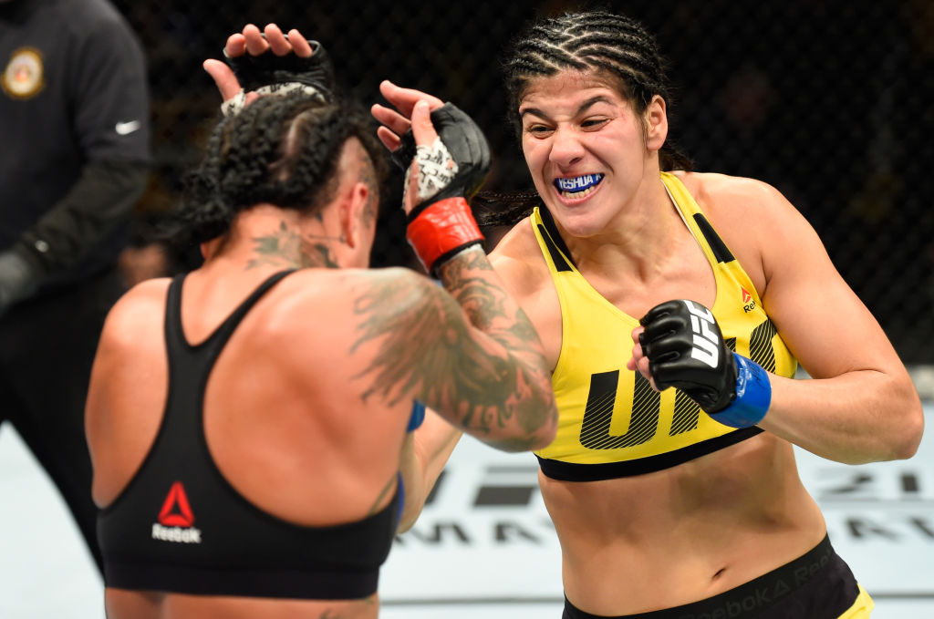 KANSAS CITY, MO - APRIL 15: (R-L) Ketlen Vieira of Brazil punches Ashlee Evans-Smith in their women's bantamweight fight during the UFC Fight Night event at Sprint Center on April 15, 2017 in Kansas City, Missouri. (Photo by Josh Hedges/Zuffa LLC)