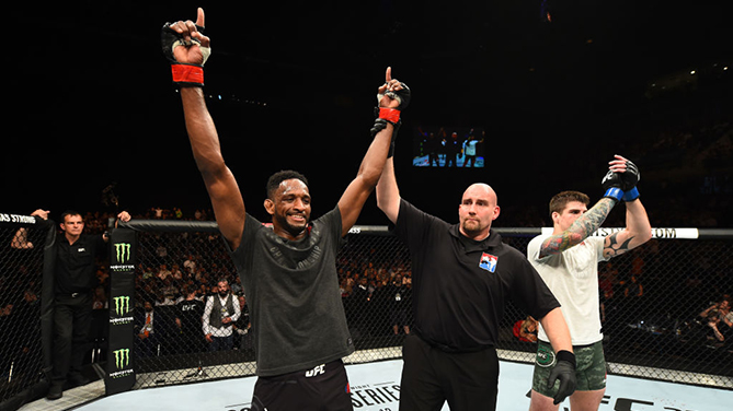 LIVERPOOL, ENGLAND - MAY 27:  (L-R) Neil Magny celebrates his victory over Craig White of England in their welterweight bout during the UFC Fight Night event at ECHO Arena on May 27, 2018 in Liverpool, England. (Photo by Josh Hedges/Zuffa LLC/Zuffa LLC vi