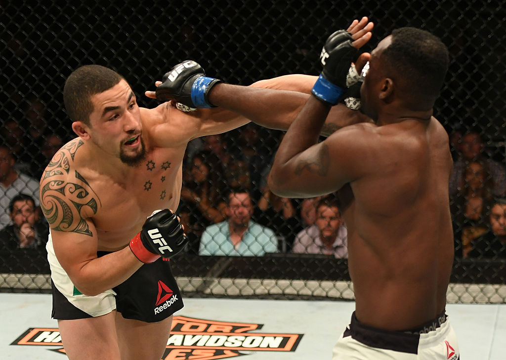 MELBOURNE, AUSTRALIA - NOVEMBER 27: (L-R) Robert Whittaker of New Zealand punches Derek Brunson in their middleweight bout during the UFC Fight Night event at Rod Laver Arena on November 27, 2016 in Melbourne, Australia. (Photo by Jeff Bottari/Zuffa LLC)