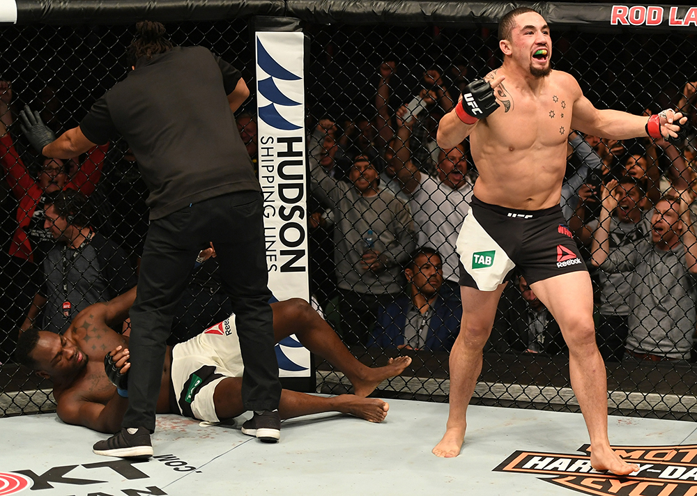 MELBOURNE, AUSTRALIA - NOVEMBER 27: Robert Whittaker of New Zealand celebrates his TKO victory over Derek Brunson in their middleweight bout during the UFC Fight Night event at Rod Laver Arena on November 27, 2016 in Melbourne, Australia. (Photo by Jeff Bottari/Zuffa LLC)