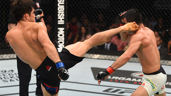 (L-R) Henry Cejudo of the United States kicks Jussier Formiga of Brazil in their flyweight bout during the UFC Fight Night event at Arena Monterrey on November 21, 2015 in Monterrey, Mexico. (Photo by Jeff Bottari/Zuffa LLC)