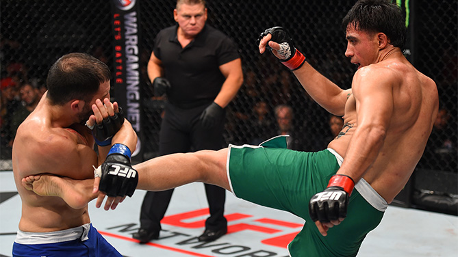 (R-L) Erick Montano of Mexico kicks Enrique Marin of Spain in their welterweight bout during the UFC Fight Night event at Arena Monterrey on November 21, 2015 in Monterrey, Mexico. (Photo by Jeff Bottari/Zuffa LLC)