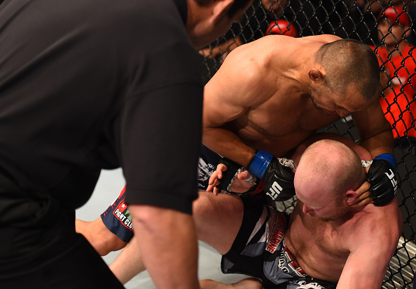 NEW ORLEANS, LA - JUNE 06:   Dan Henderson punches Tim Boetsch in their middleweight bout during the UFC event at the Smoothie King Center. (Photo by Josh Hedges/Zuffa LLC/Zuffa LLC)