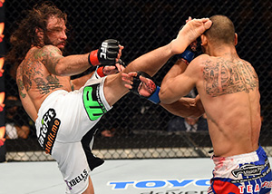 Clay Guida kicks <a href='../fighter/Robert-Peralta'>Robbie Peralta</a> in their featherweight fight during the <a href='../event/UFC-Silva-vs-Irvin'>UFC Fight Night </a>event at the Patriot Center on April 4, 2015 in Fairfax, Virginia. (Photo by Josh Hedges/Zuffa LLC)