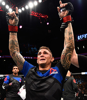 Dustin Poirier celebrates his victory over <a href='../fighter/Jim-Miller'>Jim Miller</a> in their lightweight bout during the UFC 208 event inside Barclays Center on February 11, 2017 in Brooklyn, New York. (Photo by Jeff Bottari/Zuffa LLC)