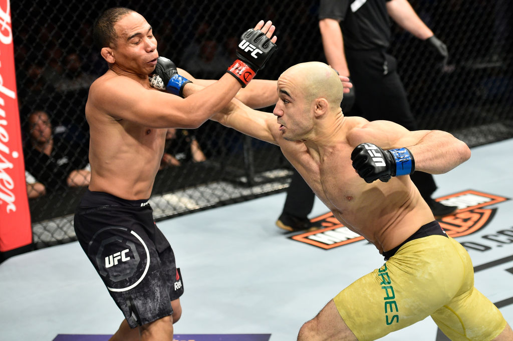 NORFOLK, VA - NOVEMBER 11: (R-L) Marlon Moraes of Brazil punches John Dodson in their bantamweight bout during the UFC Fight Night event inside the Ted Constant Convention Center on November 11, 2017 in Norfolk, Virginia. (Photo by Brandon Magnus/Zuffa LLC)