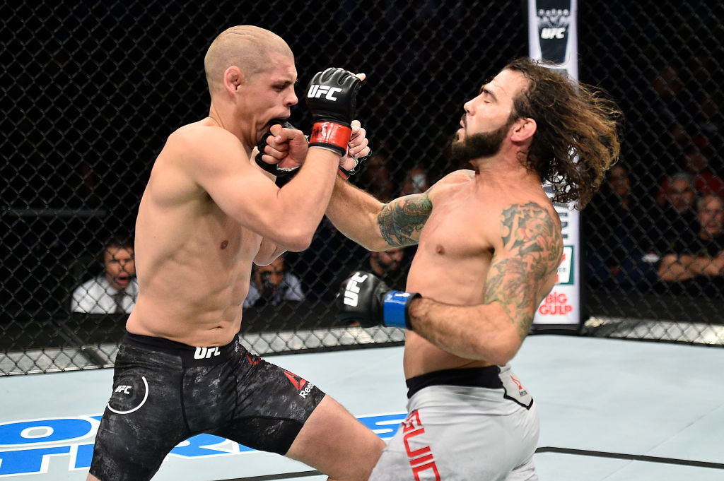 NORFOLK, VA - NOVEMBER 11:  (R-L) Clay Guida punches Joe Lauzon in their lightweight bout during the UFC Fight Night event inside the Ted Constant Convention Center on November 11, 2017 in Norfolk, Virginia. (Photo by Brandon Magnus/Zuffa LLC)