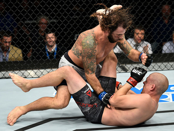<a href='../fighter/Clay-Guida'>Clay Guida</a> punches <a href='../fighter/Joe-Lauzon'>Joe Lauzon</a> in their lightweight bout during the UFC Fight Night event inside the Ted Constant Convention Center on November 11, 2017 in Norfolk, Virginia. (Photo by Brandon Magnus/Zuffa LLC)