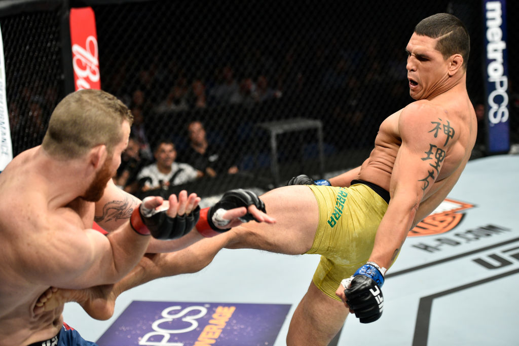 <a href='../fighter/Cezar-Ferreira'>Cezar Ferreira</a> of Brazil kicks <a href='../fighter/Nate-Marquardt'>Nate Marquardt</a> in their middleweight bout during the UFC Fight Night event inside the Ted Constant Convention Center on November 11, 2017 in Norfolk, Virginia. (Photo by Brandon Magnus/Zuffa LLC)
