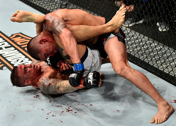 NORFOLK, VA - NOVEMBER 11:  (R-L) Anthony Pettis controls the body of Dustin Poirier in their lightweight bout during the UFC Fight Night event inside the Ted Constant Convention Center on November 11, 2017 in Norfolk, Virginia. (Photo by Brandon Magnus/Zuffa LLC)