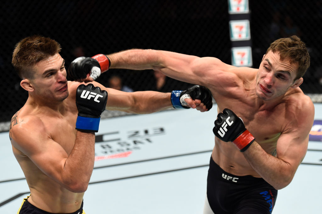 OKLAHOMA CITY, OK - JUNE 25:   (R-L) Tony Martin and Johnny Case trade punches in their lightweight bout during the UFC Fight Night event at the Chesapeake Energy Arena on June 25, 2017 in Oklahoma City, Oklahoma. (Photo by Brandon Magnus/Zuffa LLC)