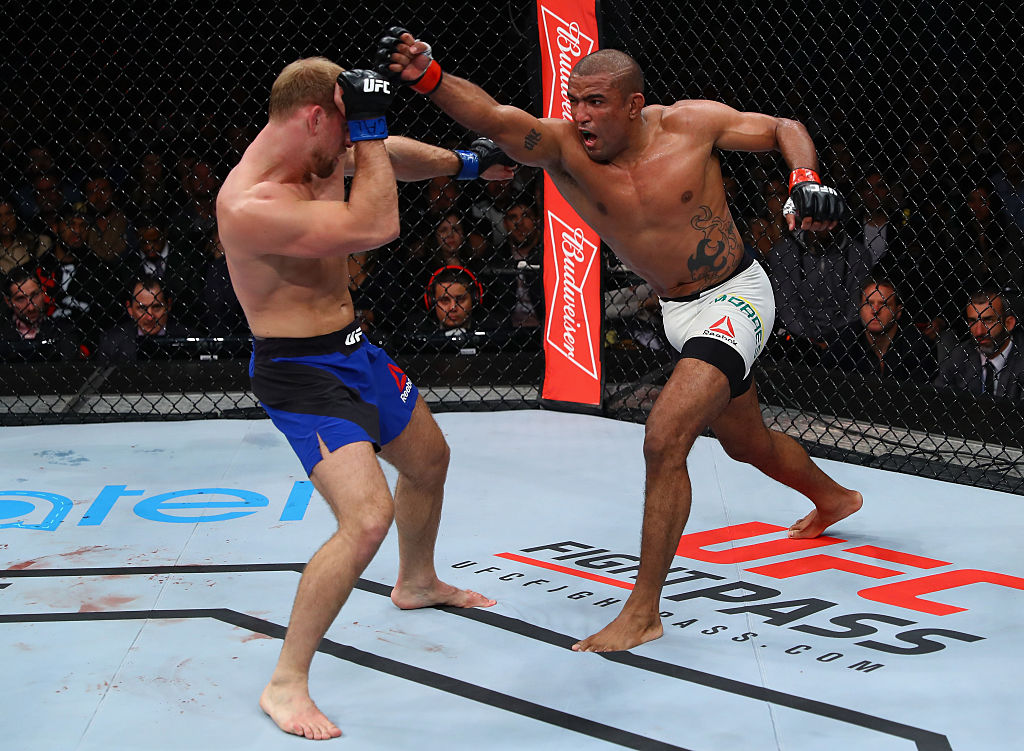 SAO PAULO, BRAZIL - NOVEMBER 19:  <a href='../fighter/Sergio-Moraes'>Sergio Moraes</a> of Brazil punches <a href='../fighter/zak-ottow'>Zak Ottow</a> of United States during their welterweight bout at the UFC Fight Night Bader v Minotouro at Ibirapuera Gymnasium on November 19, 2016 in Sao Paulo, Brazil.  (Photo by Buda Mendes/Zuffa LLC)