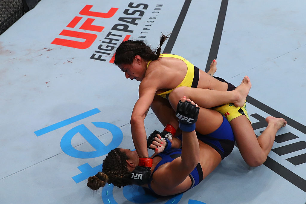 SAO PAULO, BRAZIL - NOVEMBER 19:  Claudia Gadelha of Brazil punches Cortney Casey of the United States during their women's strawweight bout at the UFC Fight Night Bader v Minotouro at Ibirapuera Gymnasium on November 19, 2016 in Sao Paulo, Brazil.  (Photo by Buda Mendes/Zuffa LLC)