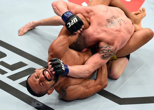 SAO PAULO, BRAZIL - OCTOBER 28:  (L-R) Deiveson Figueiredo of Brazil attempts to submit Jarred Brooks in their flyweight bout during the UFC Fight Night event inside the Ibirapuera Gymnasium on October 28, 2017 in Sao Paulo, Brazil. (Photo by Josh Hedges/Zuffa LLC/Zuffa LLC via Getty Images)