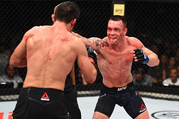 SAO PAULO, BRAZIL - OCTOBER 28:  (R-L) Colby Covington punches Demian Maia of Brazil in their welterweight bout during the UFC Fight Night event inside the Ibirapuera Gymnasium on October 28, 2017 in Sao Paulo, Brazil. (Photo by Josh Hedges/Zuffa LLC/Zuffa LLC via Getty Images)