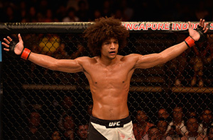 Alex Caceres reacts to the doctor stoppage for <a href='../fighter/Rolando-Dy'>Rolando Dy</a> of the Philippines in their featherweight bout during the UFC Fight Night event at the Singapore Indoor Stadium on June 17, 2017 in Singapore. (Photo by Brandon Magnus/Zuffa LLC)