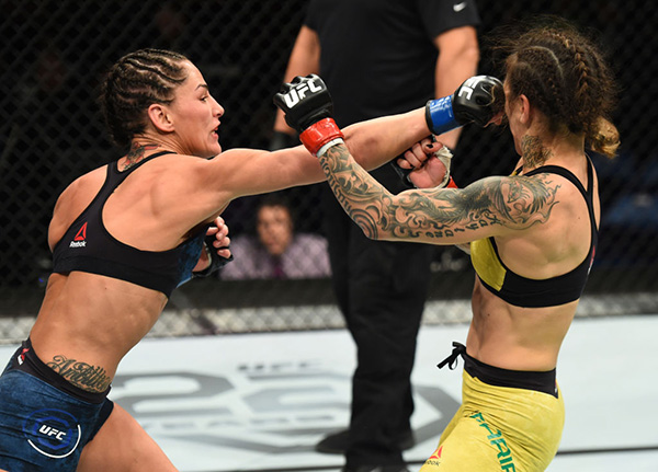 ST. LOUIS, MO - JANUARY 14: (L-R) Jessica Eye punches Kalindra Faria of Brazil in their women's flyweight bout during the UFC Fight Night event inside the Scottrade Center on January 14, 2018 in St. Louis, Missouri. (Photo by Josh Hedges/Zuffa LLC)