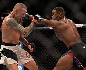 Will Brooks punches Ross Pearson in their lightweight bout during The Ultimate Fighter Finale event at MGM Grand Garden Arena on July 8, 2016 in Las Vegas, Nevada.  (Photo by Brandon Magnus/Zuffa LLC)
