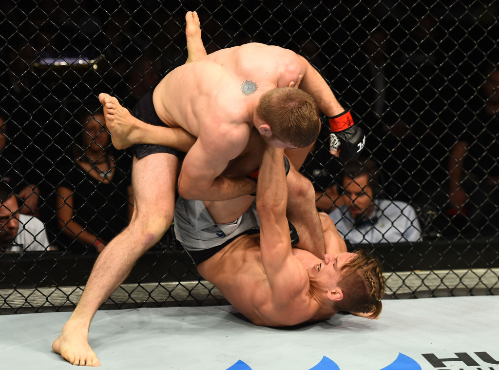 Jake Matthews punches Bojan Velickovic during their welterweight bout at Fight Night Sydney