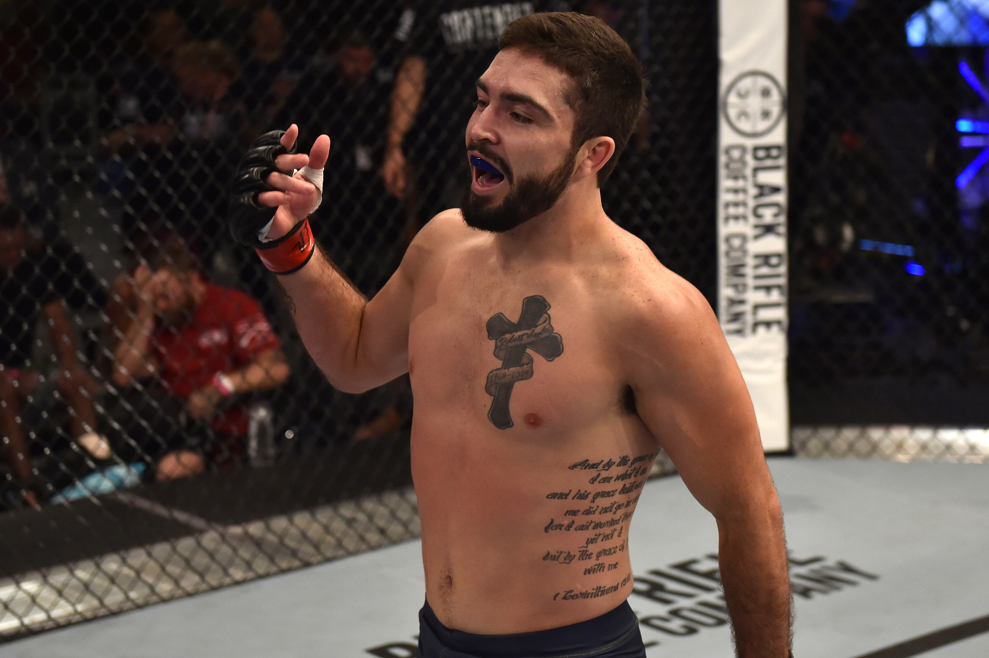 LAS VEGAS, NV - JUNE 19: Matt Sayles celebrates after his victory over <a href='../fighter/Yazan-Hajeh'>Yazan Hajeh</a> in their featherweight bout during Dana White's Tuesday Night Contender Series at the TUF Gym on June 19, 2018 in Las Vegas, Nevada. (Photo by Elliott Howard/DWTNCS LLC)