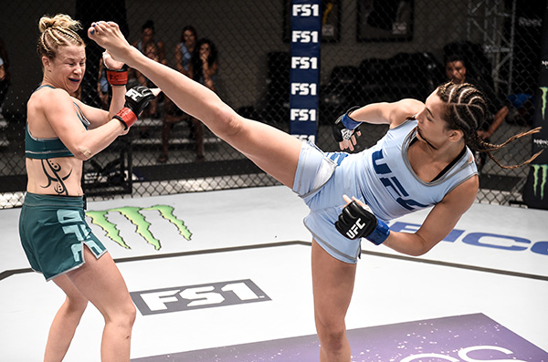 Montana Stewart kicks Ariel Beck during her opening round fight in The Ultimate Fighter