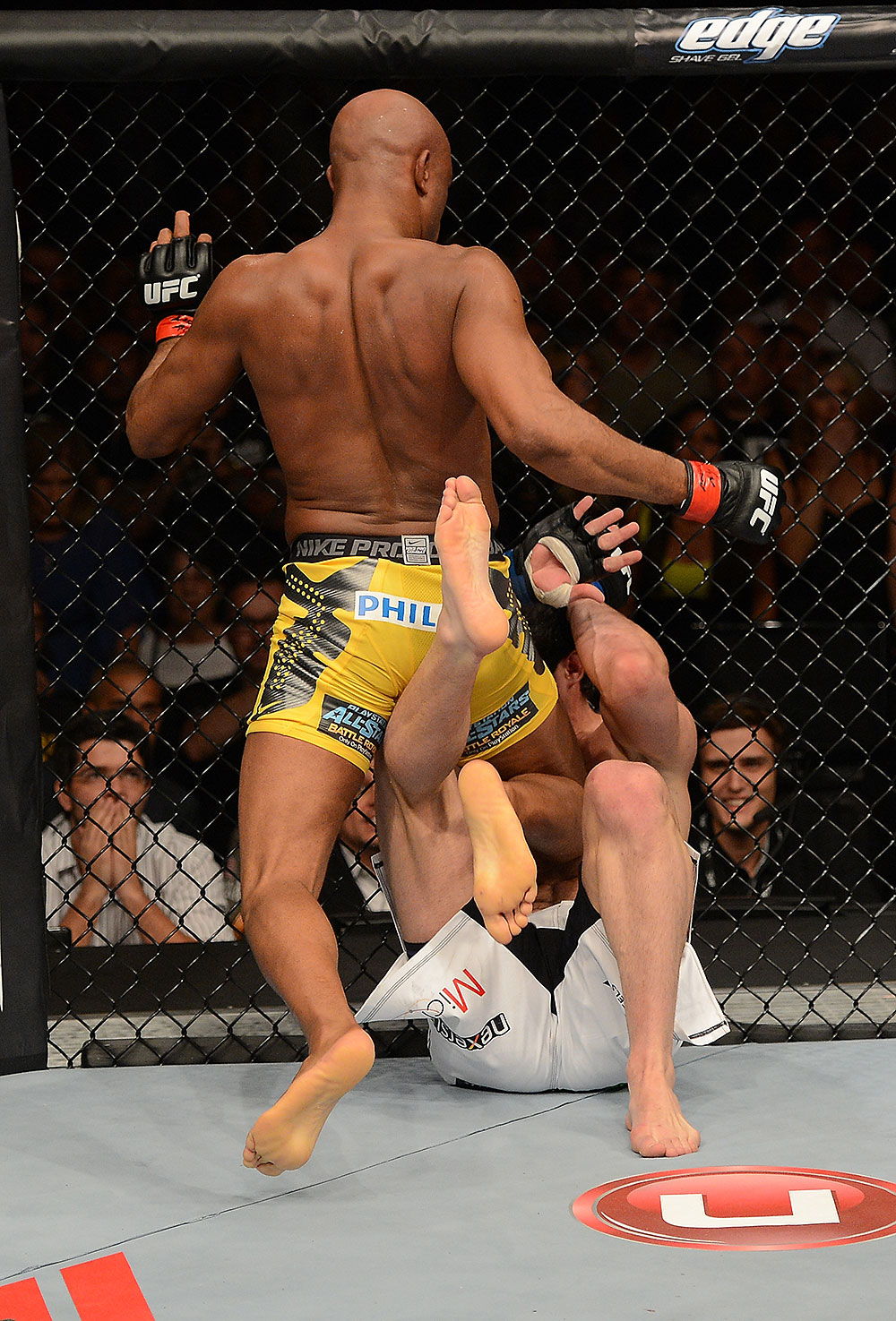 Anderson Silva knees Chael Sonnen during their rematch at UFC 148