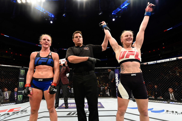 CHICAGO, IL - JULY 23:  (R-L) Valentina Shevchenko of Kyrgyzstan celebrates after defeating Holly Holm by unanimous decision in their women's bantamweight bout during the UFC Fight Night event at the United Center on July 23, 2016 in Chicago, Illinois. (P
