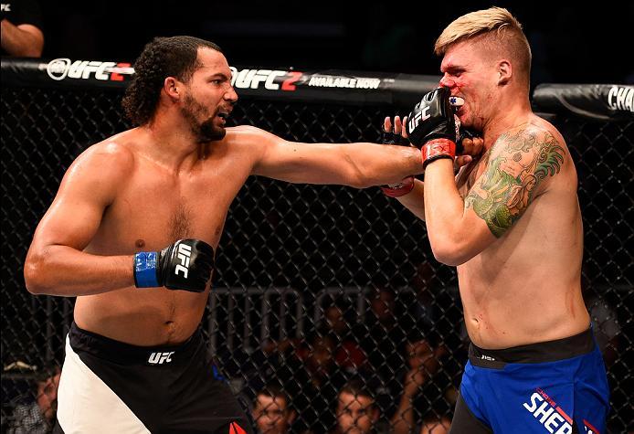 <a href='../fighter/justin-ledet'>Justin Ledet</a> punches <a href='../fighter/chase-sherman'>Chase Sherman</a> during his UFC debut at Fight Night Salt Lake City