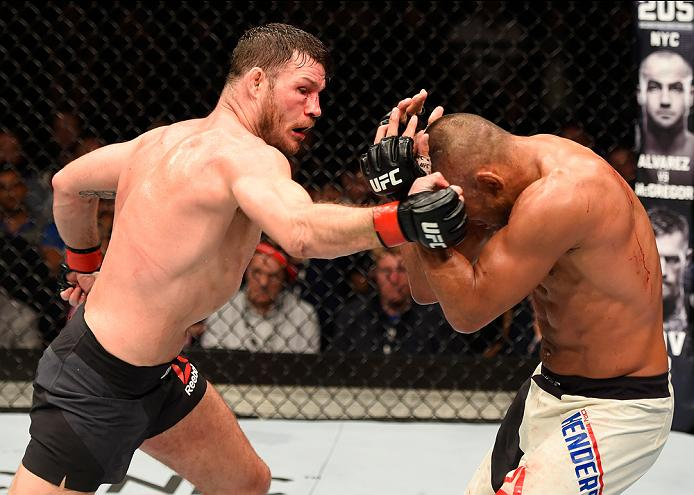 MANCHESTER, ENGLAND - OCTOBER 08: (L-R) Michael Bisping of England punches Dan Henderson in their UFC middleweight championship bout during the UFC 204 Fight Night at the Manchester Evening News Arena on October 8, 2016 in Manchester, England. (Photo by Josh Hedges/Zuffa LLC)