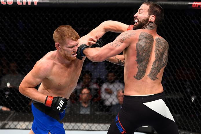 MEXICO CITY, MEXICO - NOVEMBER 05: (L-R) Sam Alvey of the United States punches Alex Nicholson of the United States in their middleweight bout during the UFC Fight Night event at Arena Ciudad de Mexico on November 5, 2016 in Mexico City, Mexico. (Photo by Jeff Bottari/Zuffa LLC)