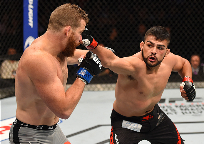 (R-L) Kelvin Gastelum of the United States punches Nate Marquardt of the United States in their middleweight bout during the UFC 188 event at the Arena Ciudad de Mexico on June 13, 2015 in Mexico City, Mexico. (Photo by Josh Hedges/Zuffa LLC)
