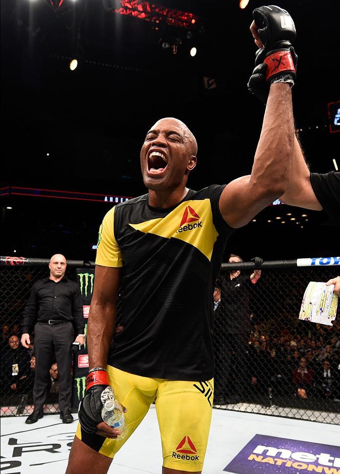 Anderson Silva celebrates after defeating Derek Brunson at UFC 208