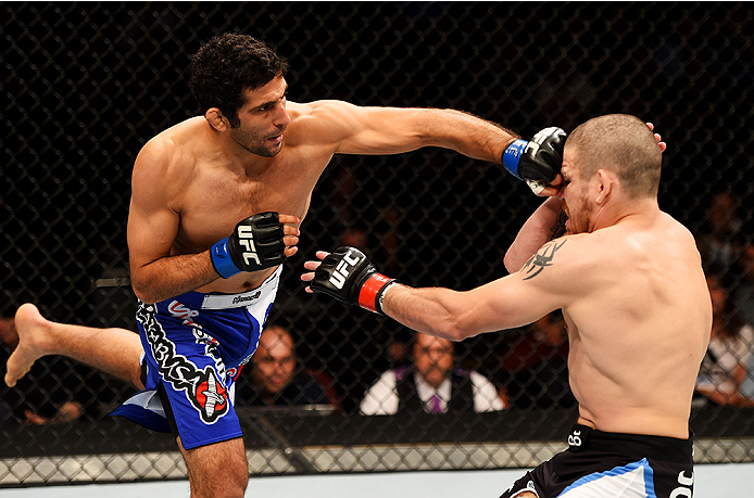 Beneil Dariush (L) of Iran punches <a href='../fighter/Jim-Miller'>Jim Miller</a> in their lightweight bout during the UFC Fight Night event at Prudential Center on April 18, 2015 in Newark, New Jersey. (Photo by Josh Hedges/Zuffa LLC/Zuffa LLC via Getty Images)