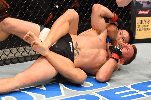 AUCKLAND, NEW ZEALAND - JUNE 11: (R-L) Ben Nguyen submits Tim Elliott in their flyweight fight during the UFC Fight Night event at the Spark Arena on June 11, 2017 in Auckland, New Zealand. (Photo by Josh Hedges/Zuffa LLC/Zuffa LLC via Getty Images)