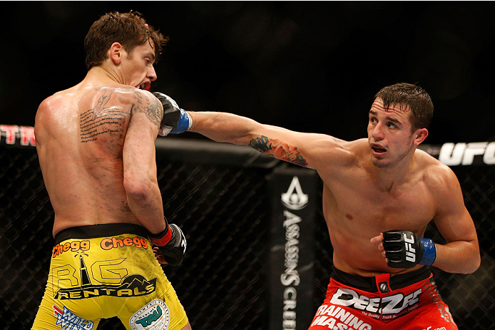 (R-L) Myles Jury punches Mike Ricci in their UFC lightweight bout at the Air Canada Center on September 21, 2013 in Toronto, Ontario, Canada. (Photo by Josh Hedges/Zuffa LLC)