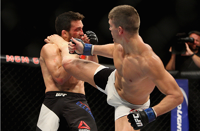 Stephen Thompson kicks Jake Ellenberger in their welterweight bout during the Ultimate Fighter Finale. (Photo by Mitch Viquez/Zuffa LLC)