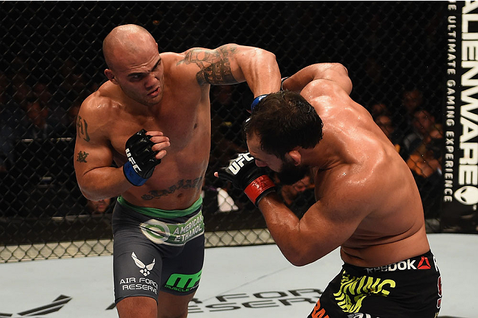 (L-R) Robbie Lawler punches Johny Hendricks in their UFC welterweight championship bout during the UFC 181 event inside the Mandalay Bay Events Center on 12/6/14 in Las Vegas, NV. (Photo by Robert Laberge/Zuffa LLC)