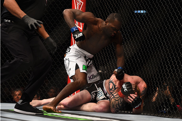 Derek Brunson punches Ed Herman in their middleweight bout during the UFC 183 event at the MGM Grand Garden Arena on January 31, 2015 in Las Vegas, NV. (Photo by Jeff Bottari/Zuffa LLC)