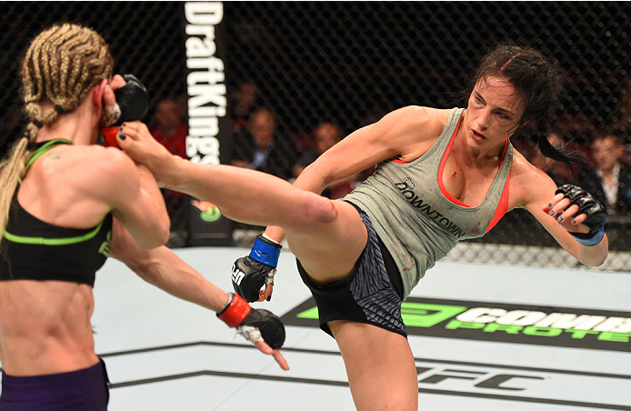 Valerie Letourneau kicks Jessica Rakoczy in their women's strawweight bout during the UFC 186 event on April 25, 2015 in Montreal, Quebec, Canada. (Photo by Josh Hedges/Zuffa LLC)